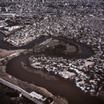 An aereal view of The Riachuelo, where the river divides Avellaneda, in the province, and the Villa 21-24, in Buenos Aires. This slum is the biggest in Buenos Aires with 60,000 inhabitants, and it has the highest concentration of people affected by the pollution of the river, with the higest rates of respiratory illnesses.