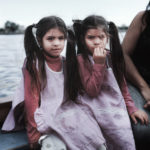 Maite and Bianca, twins, 5 years old, cross the Riachuelo River in a boat. They live in Isla Maciel and cross every day the river to Buenos Aires to go to the kindergarden.